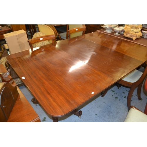 1543 - George IV style mahogany three pillar dining table on turned supports with platform bases and scroll...
