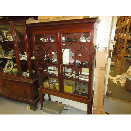 1550 - Late Georgian mahogany bookcase top on a later stand, with a moulded dentil cornice above two astrag...