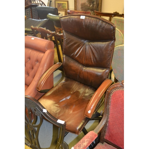 1551 - 20th Century brown leather upholstered revolving office armchair...