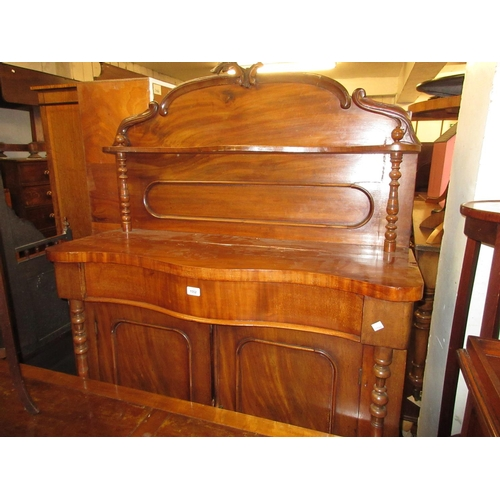 1552 - Small Victorian mahogany serpentine fronted chiffonier with a shelf back and two panelled doors, 41i...