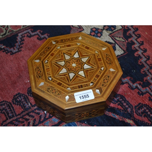 1555 - Middle Eastern octagonal wooden parquetry and mother of pearl inlaid jewel casket...