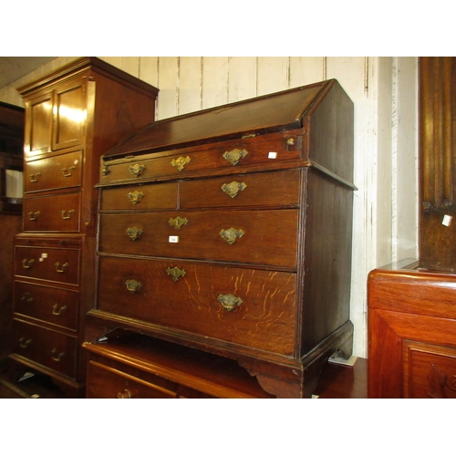 1568 - 18th Century oak bureau, the fall front enclosing a fitted interior with well above two short and tw...