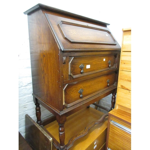 1578 - Early 20th Century oak bureau together with a similar bookcase with leaded glass doors...