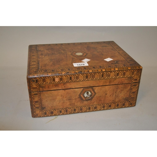 1579 - Victorian walnut and parquetry inlaid work box, the hinged cover enclosing a fitted interior with li...