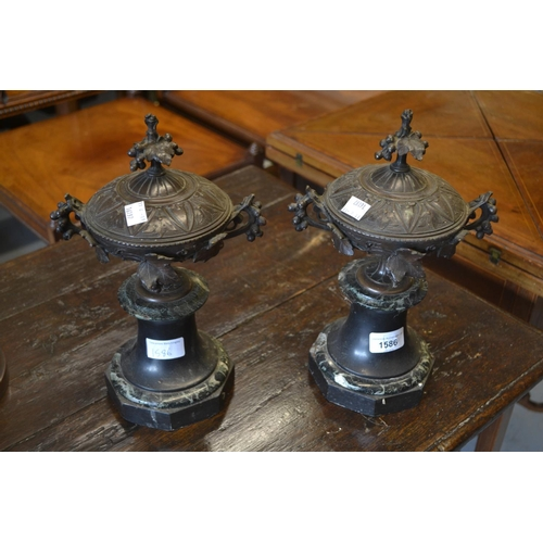 1586 - Pair of late 19th / early 20th Century French brown patinated bronze covered urns on circular black ...