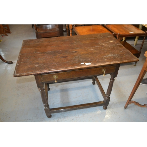 1589 - 18th Century oak side table with a moulded plank top above a single frieze drawer raised on turned s...