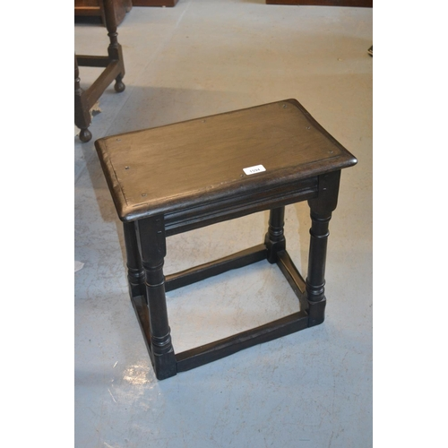 1594 - Reproduction dark oak joint stool raised on turned supports with stretchers...