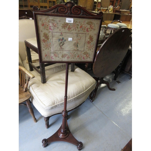 1600 - 19th Century mahogany pole screen with a needlepoint panel and triform base...