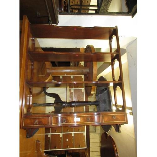 1606 - Reproduction mahogany three shelf wall bracket with three small drawers to the base...