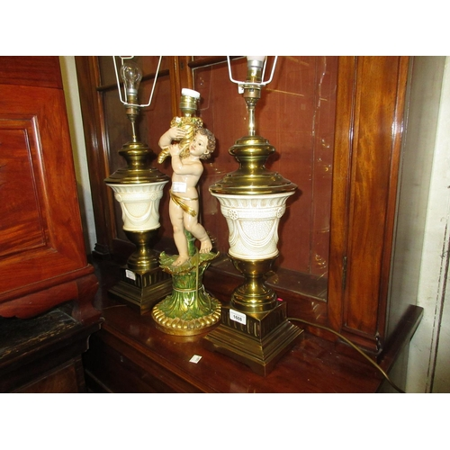 1608 - Pair of reproduction cream glazed pottery and brass mounted table lamps together with a gilded and p...