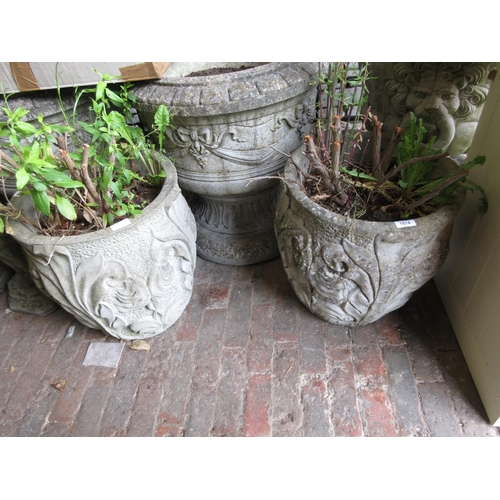 1614 - Pair of weathered cast concrete garden planters, relief decorated with acanthus leaves...
