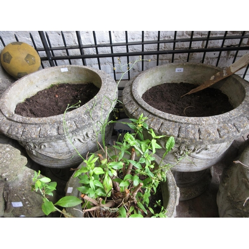 1616 - Pair of large cast concrete garden planters decorated in relief with swags and bows...