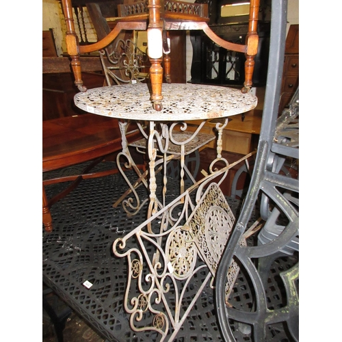 1617 - Small circular metal garden table and a pair of matching folding chairs...
