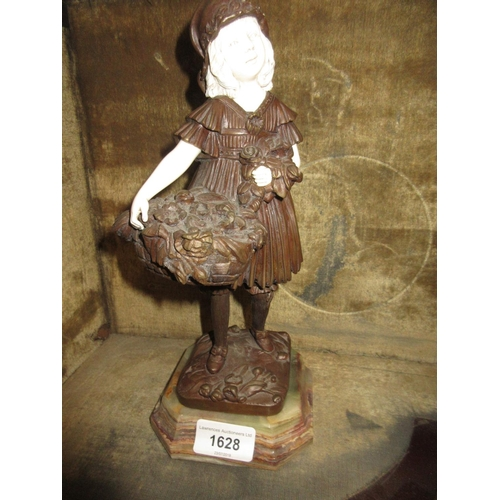 1628 - Reproduction bronze and ivorine figure of a girl carrying a basket of flowers after Chiparus, 10.5in...