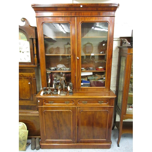 1631 - Victorian mahogany bookcase, the moulded cornice above a pair of glazed doors, two drawers and two c...