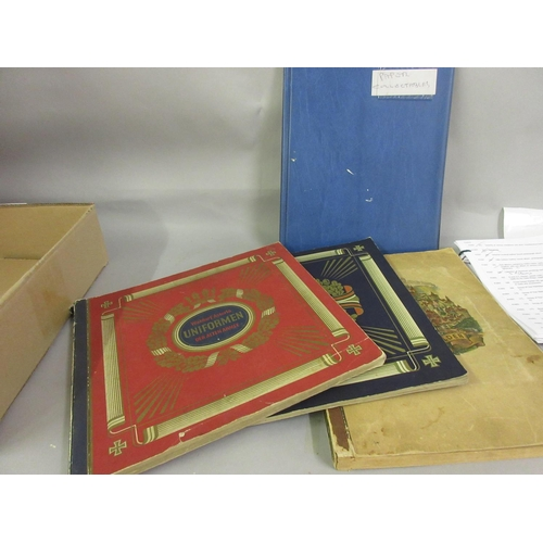 165 - Two albums containing 1930's colour cards of German Army and Navy, together with one album of variou...
