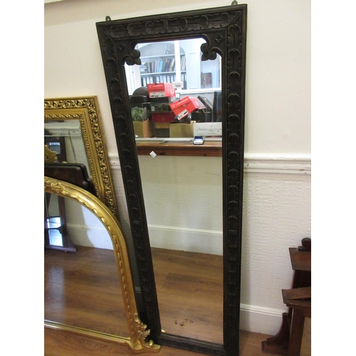 1650 - Full length carved oak framed wall mirror, 63ins x 20ins...