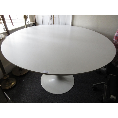 1699 - After Eero Saarinen, a tulip type circular dining table, the white laminate top above a white coated...
