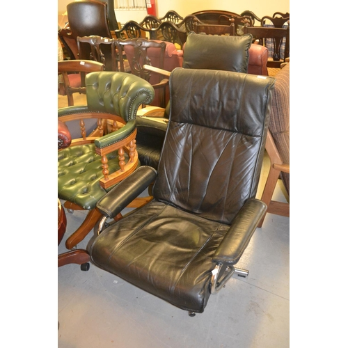 1909 - 20th Century Norwegian black leather upholstered and chrome reclining armchair, together with a blac...