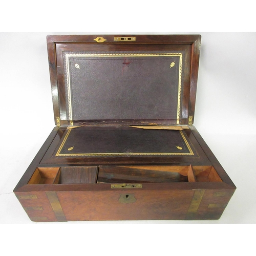 1938 - 19th Century rosewood and brass bound rectangular foldover writing box...