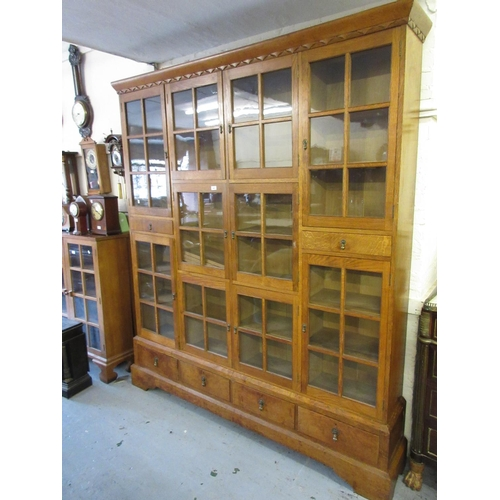 1941 - Large mid 20th Century oak bookcase with an arrangement of various small glazed doors and drawers ra...
