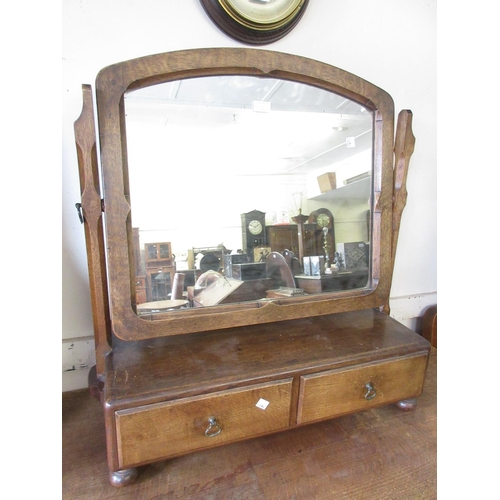 1942 - Arts and Crafts oak dressing table with matching swing frame mirror together with a matching five dr...