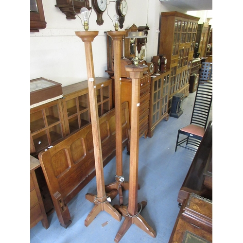 1947 - Group of four Arts and Crafts oak octagonal tapering standard lamps...