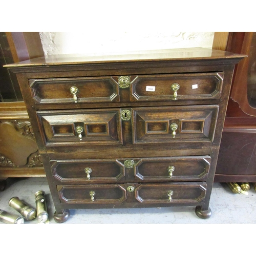 1958 - Early 18th Century oak moulded front straight front chest of four long drawers with brass drop handl...