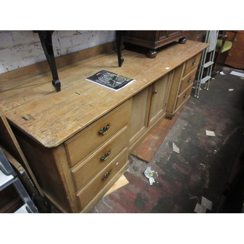 1964 - Large 19th Century stripped pine side cabinet with two centre panel doors flanked by six small drawe...