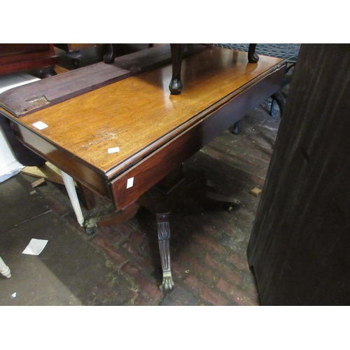 1967 - George III mahogany drop leaf breakfast table on square tapering column and quadruped splay supports...
