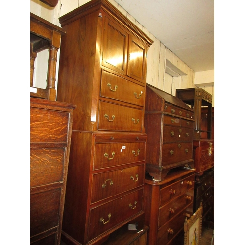 1969 - Small 20th Century mahogany tallboy with a moulded dentil cornice above two doors, brushing slide an...