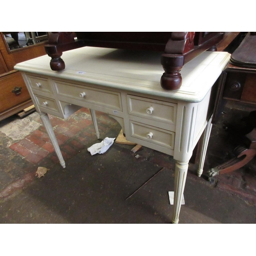 1971 - Cream painted kneehole dressing table on fluted supports together with a pair of matching bedside ta...