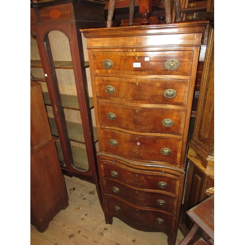1979 - Small 20th Century walnut and crossbanded serpentine fronted tallboy of seven long drawers with brus...