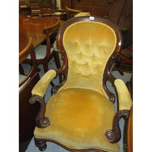 1983 - Victorian carved walnut gold velvet button upholstered balloon back open elbow chair raised on turne...