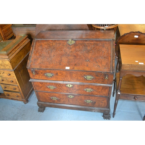 1991 - Early 18th Century walnut and herringbone crossbanded bureau, the fall front enclosing a fitted inte...