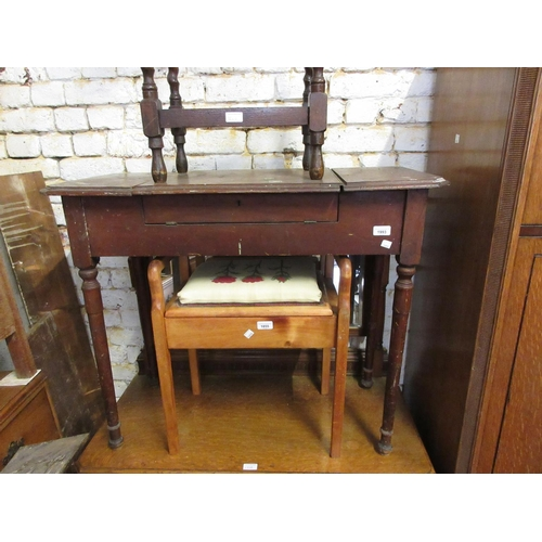 1993 - Small late Victorian mahogany writing table with a triple hinged cover enclosing a fitted interior, ...