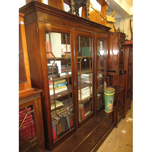 1994 - Mahogany bookcase, the moulded cornice above three satinwood crossbanded and astragal glazed doors, ...