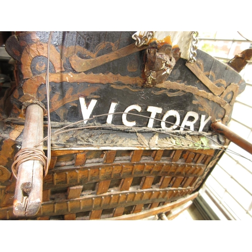 1999 - Large scratch built and painted wooden model of H.M.S. Victory on stand, approximate overall length ...