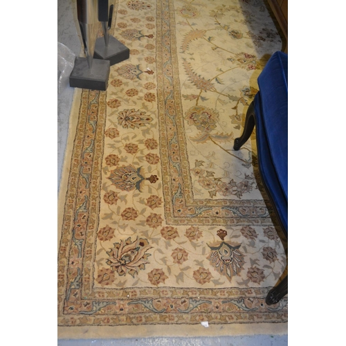 2 - Indo Persian style carpet of all-over floral design with multiple borders on a beige ground, 9ft 10i...