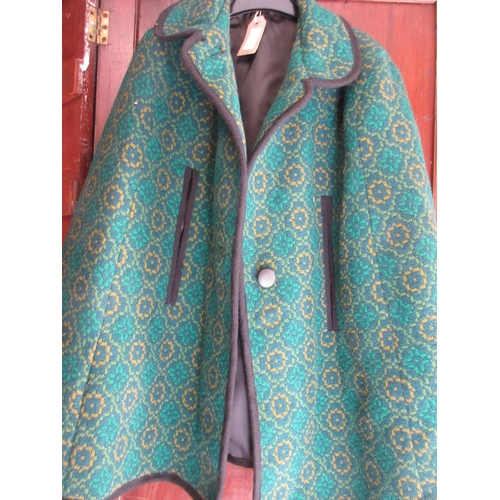20 - Ladies black three quarter length jacket, a ladies green woollen cape and four various handbags (fro...