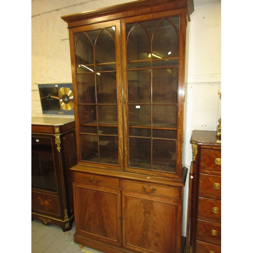 2001 - George IV mahogany bookcase, the moulded cornice above a pair of arched bar glazed panel doors enclo...