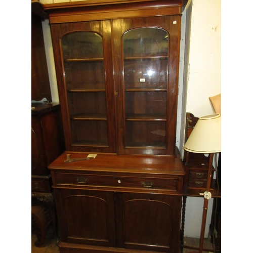 2005 - Victorian mahogany bookcase, the moulded cornice above two glazed doors, a long drawer and two panel...