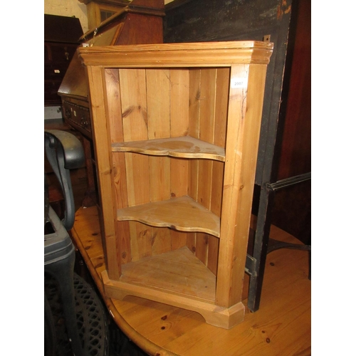 2007 - Small stripped pine hanging open shelved corner unit...
