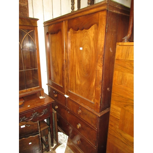 2015 - Victorian mahogany linen press with a pair of arched doors above two short and two long drawers on a...
