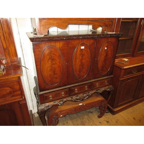 2018 - Reproduction mahogany cocktail cabinet with oval panelled doors above three drawers raised on carved...