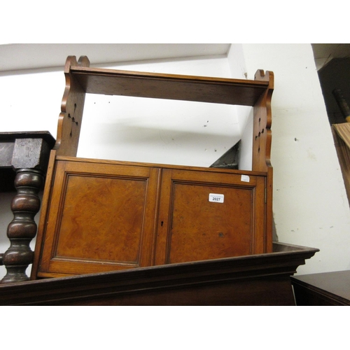 2027 - Late Victorian oak wall bracket with open shelves above two panel doors and Gothic style pierced sid...
