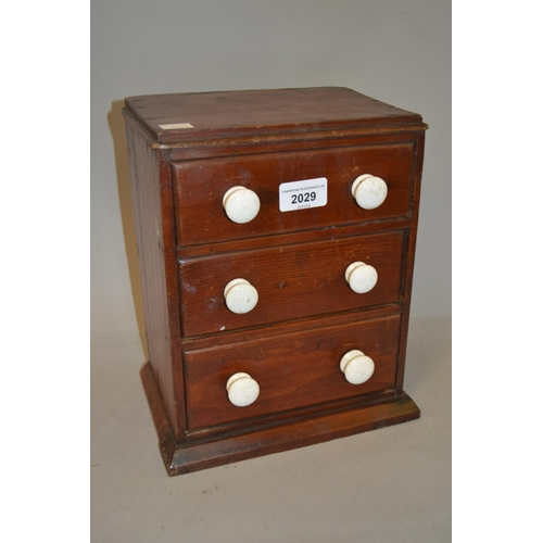 2029 - 19th Century miniature three drawer table top chest with white ceramic handles...