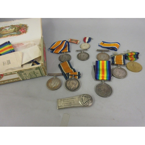 265 - World War I group of two medals awarded to Private H. Taelman A.S.C., four 1914 / 1918 World War   m...