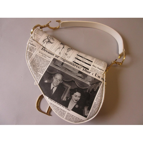 28 - Christian Dior, black and white newspaper print leather saddle bag, from the Fall 2000 Runway, compl...