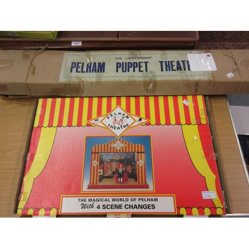 291 - Early lightweight Pelham puppet theatre in original box, together with a later Pelham puppet theatre...
